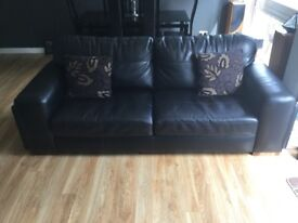 2 x black leather 3 seater sofas & matching footstool, excellent condition