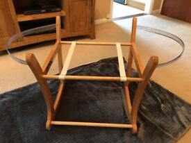 A Moses basket rocking stand