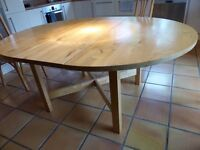 Solid hardwood Ikea extendable circular dining table