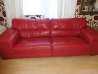 Large red leather sofa for sale.