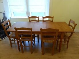 Pine wood dining room table with 6 chairs. Can be shortened to a 4 chair setup.