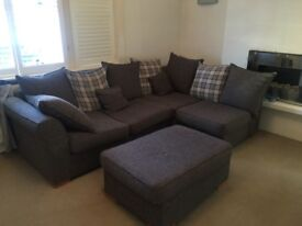 Lovely corner sofa with footstool available in the Clapham area