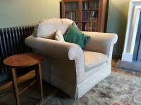 Laura Ashley armchair in a cream linen fabric.