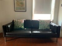 Lovely Faux leather IKEA sofa clean lines