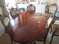 Italian effect dining table, 6 chairs including 2 carver chairs, matching cabinet.