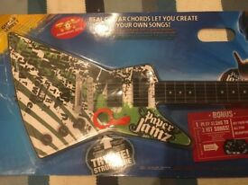 Guitar Christmas gift . New stilll in packaging . Grab a bargain £8