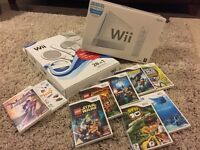 New Wii console, a large number of accessories and used games.