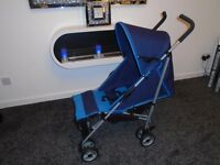 Almost new lie flat umberella buggy with new raincover