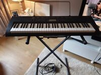 Casio electric keyboard Ctk-1150 includes stand