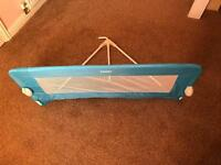 Like new blue Tomy bed guard