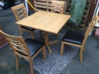 Wood table and four chairs good fully functional condition