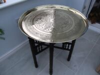Antique, engraved, brass topped, circular table, 58cms diameter, 51cms tall