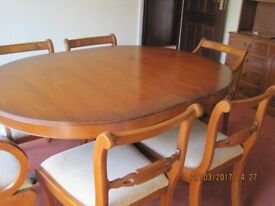 Dining Room Table, yew coloured in a polished finish. Comes with 6 chairs, 2 carvers and 4 standard