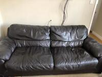 2 LARGE BROWN SOFAS AND STORAGE FOOTSTALL