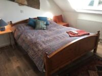 Beautiful solid pine double bed with twin zip-link mattresses.