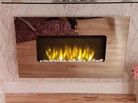 Mirrored wall hung electric fire