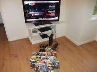xbox 360 slim 250 gb and loads games