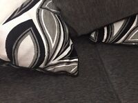 Black and white two seater sofa with matching cushions as new