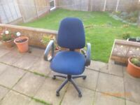 computer chair covered in a dark blue material with gas lift and back tilt