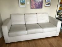 Comfortable 3 seater beige sofa bed in good condition from Sofaworkshop.