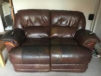 Two seater electric reclining leather sofa