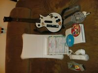 Nintendo Wii with guitar Hero and about 15 games.