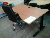 Brown waved office desk and swivel chair