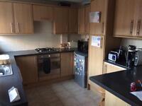 Kitchen cupboards and worktops.