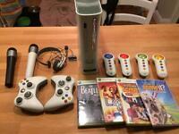 Xbox 360 + games + microphones + guitar