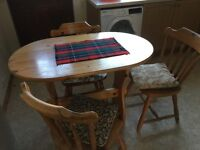 Small pine dining table and 4 chairs
