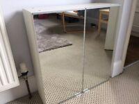 Mirrored IKEA bathroom cabinet for sale