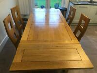 Oak Dining table and 4 chairs. Very good condition.