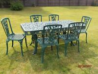 Cast Iron patio table and 6 chairs