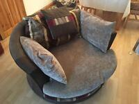 Brown swivel chair with pillows sofa cuddle