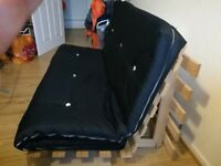 Black sofa which also folds out into a double bed. Wooden frame and mattress included