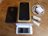 Unlocked, boxed Galaxy s5 with extra battery