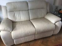 Cream 2 seater leather sofa.