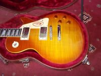 2 Guitars for sale or exchange , Chibson les pauls type flame maple and one flame necked