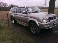 04 reg mitsubishi L200 warrior double cab pick up with fitted canopy . full leather .