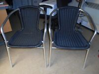 x2 Black Plastic Wicker, Rattan Chairs. Chrome Legs. Ideal Bistro / Patio / Spare etc