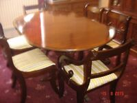 Vintage Regency style mahogany extendable Oval dining table