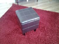 Footstool with storage in brown bicast leather.