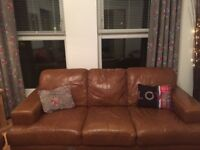 Two 3 seater tan leather sofas