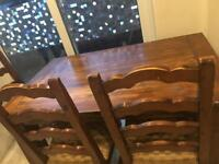 Solid wooden table with 3 chairs