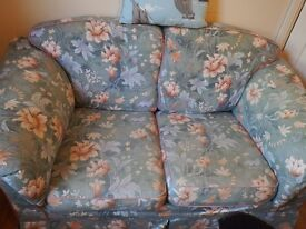 Green Floral sofa and foot stool