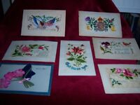 6 World War 1 Silk Embroidered Postcards and 1 Silk Flower Postcard