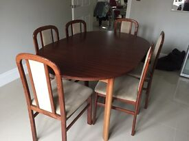 Dark wood 6 seater extending table and chairs