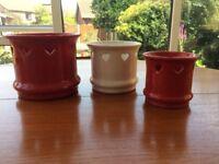 Three pretty ceramic plant pots with heart detail