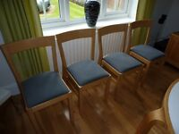 """IKEA dining table and four matching chairs. Extends from 3'6"""" circle to 6'5"""""""