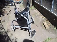 MOBILITY WALKING AID IN GOOD CONDITION HAS STORAGE BAG CAN DELIVER